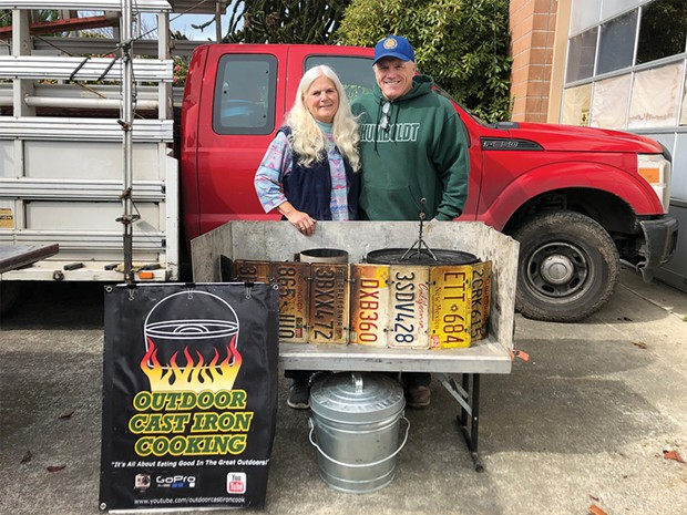 Joanie Hartman-Hubbard and Dean Hubbard with their custom outdoor cooking setup outside their converted firehouse.