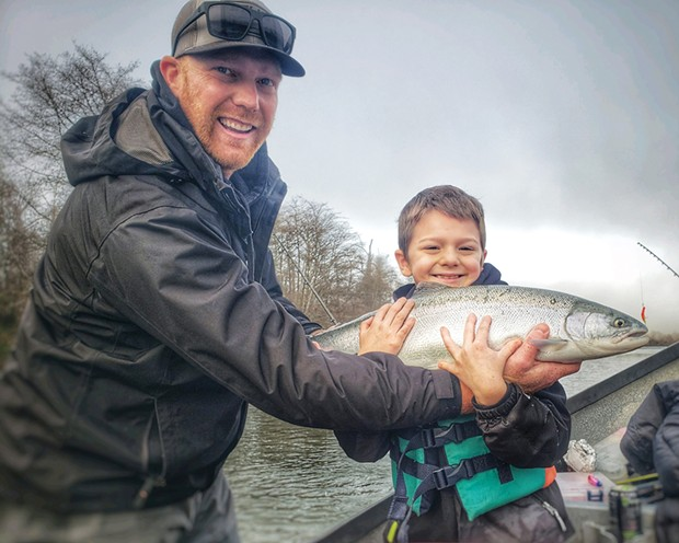Eight-year-old Bryson Blevin, along with dad Tyler, are all smiles after the young angler landed his first-ever steelhead while fishing the Mad River on Saturday.