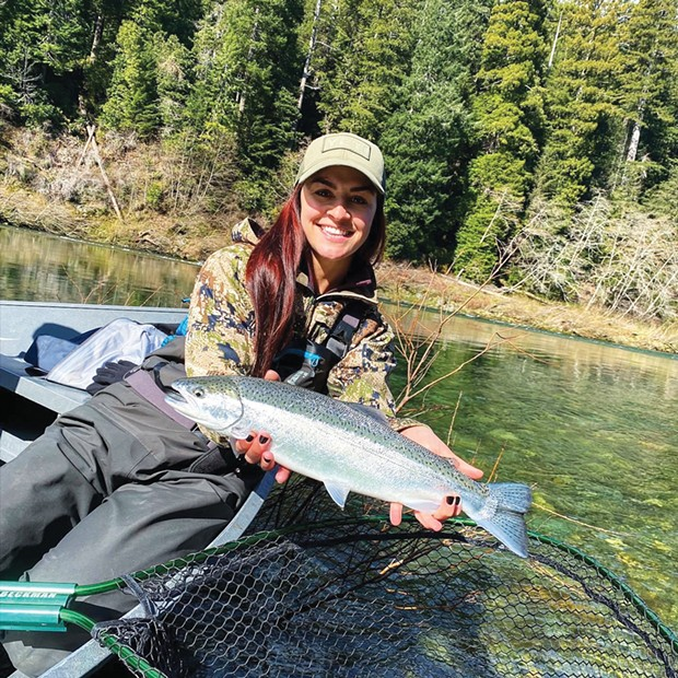 Haley Richards, of Salem, Oregon, holds a steelhead she caught and released March 13 while fishing the Smith River with guide Rye Phillips      of Wild Rivers Fishing.