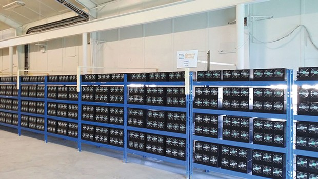 """A node in the Bitcoin network is usually a """"mining farm,"""" like this one (in Iceland, taking advantage of cheap geothermal and hydro power), in which thousands of ASIC (application-specific integrated circuit) computers compete in a worldwide lottery to find the winning Bitcoin """"hash."""""""