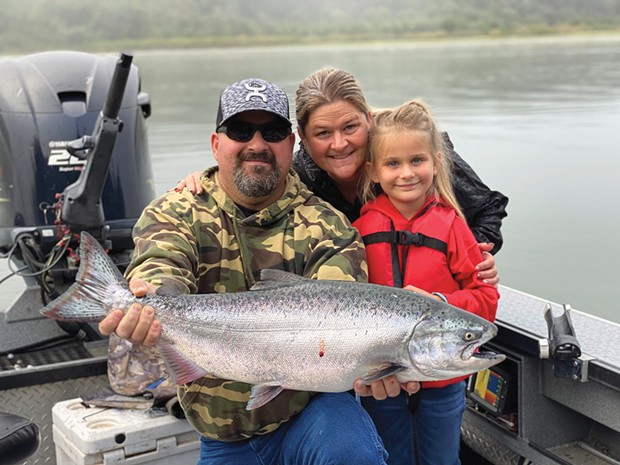 Ruby Dawn, with a little help from her father Pat and mother Michele, landed her first-ever salmon while fishing the Klamath River Saturday.