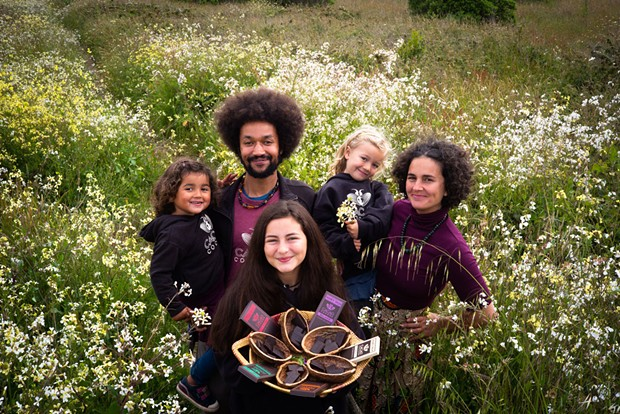 Elissa Verdillo and Zach Funk with their daughters, Solstice, Ominira and Mbeya.
