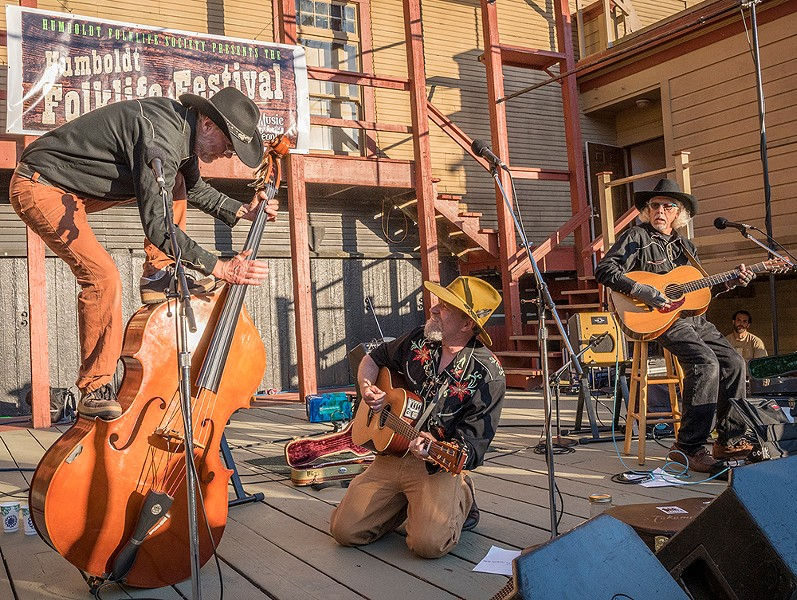 Joe King of Kingfoot was brought to his knees while watching bass player Kevin Johnson perform some acrobatics on his bass. - PHOTO BY MARK LARSON