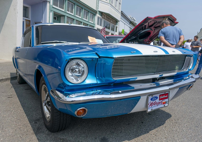 Josua DeGraw's 1966 Class 2B blue Mustang glistens in the sun on Main Street on July 28 at the Fortuna Redwood AutoXpo. - PHOTO BY MEGAN BENDER