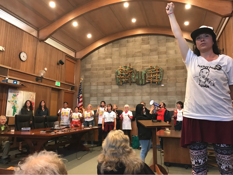 Protestors disrupt Wednesday's Arcata City Council meeting. - PHOTO BY RYAN HUTSON