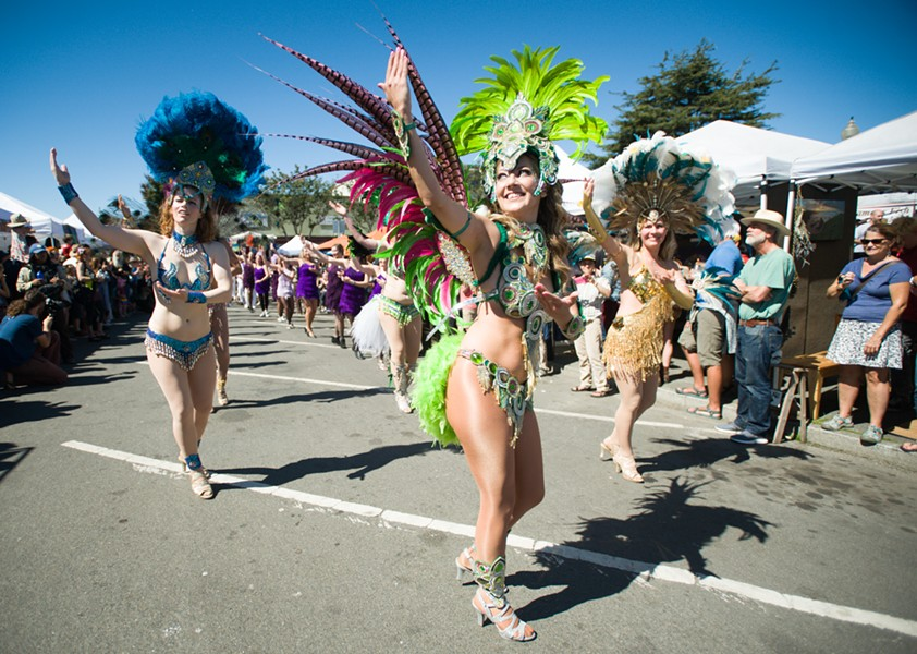 Samba dancers shook a tail feather near the end of the parade. - PHOTO BY MARK MCKENNA