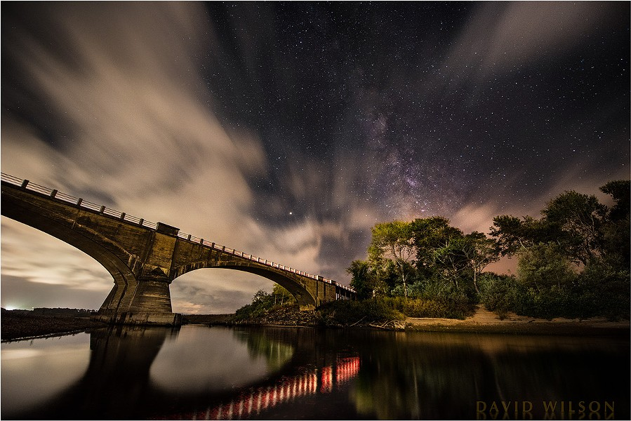 Historic Fernbridge sits out in the cosmos beneath a layer of sweeping clouds and the majestic Milky Way. Mars is bright at center. The lights from passing cars illuminated the shore and provided the reflections. Sept. 11, 2018. - DAVID WILSON