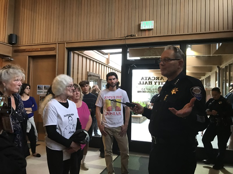 Arcata Interim Police Chief Richard Ehle offers an update on the investigation into the stabbing death of David Josiah Lawson after protesters disrupted a council meeting in August. - CARMEN PENA-GUTIERREZ