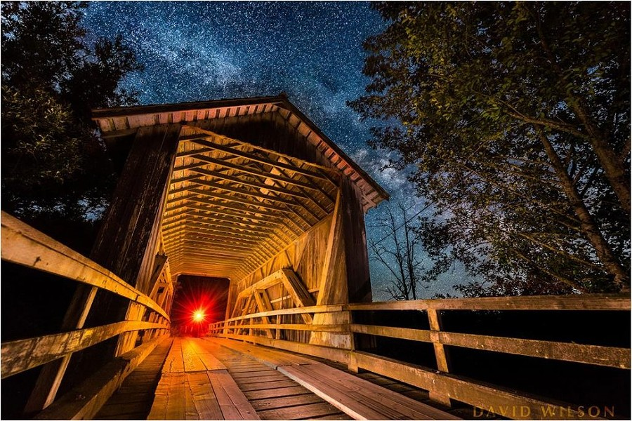 Also off of Elk River Road, Zanes Road covered bridge is another half-mile or so past Berta Road. The red light at the end of the tunnel is me holding my headlamp. - DAVID WILSON