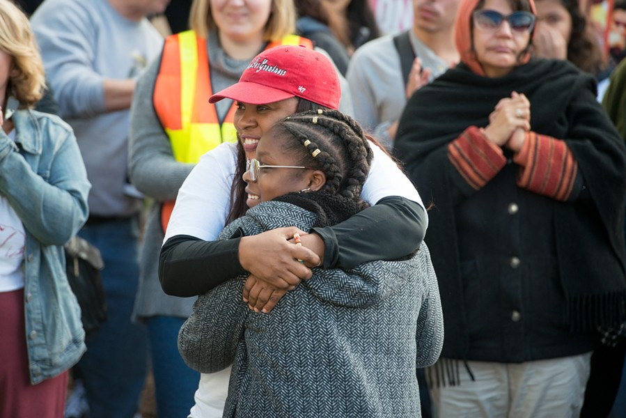 Charmaine Lawson hugs Sadie Shelmire, 11, after Shelmire spoke of the racism she has experienced in Humboldt County. - MARK MCKENNA