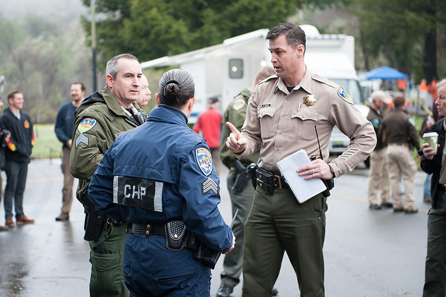 Humboldt County Sheriff William Honsal speaks with representatives from multiple agencies before the March 3 morning briefing. - PHOTO BY MARK MCKENNA