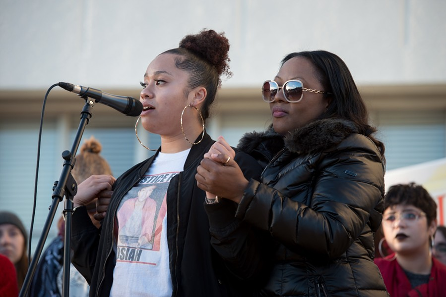 Humboldt State Student Janaee Sykes speaks to the crowd as Charmaine Lawson holds her hands. - MARK MCKENNA