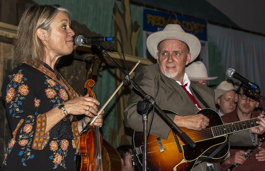 Elana James and Dave Stuckey share a moment during the Western Swing All Stars' performance on Friday night at the Adorni Center. - PHOTO BY MARK LARSON
