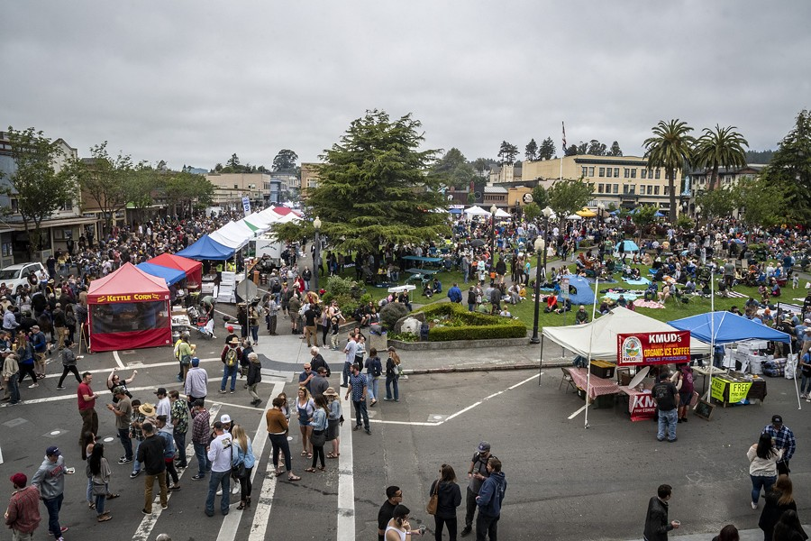 Thousands gathered on the Arcata Plaza to stand in line to buy oysters, listen to music or have a picnic on the grass. - PHOTO BY MARK LARSON