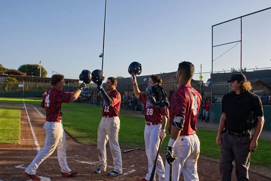 Bryce Kirk is congratulated by his team after hitting his second home run of the game - MATT FILAR