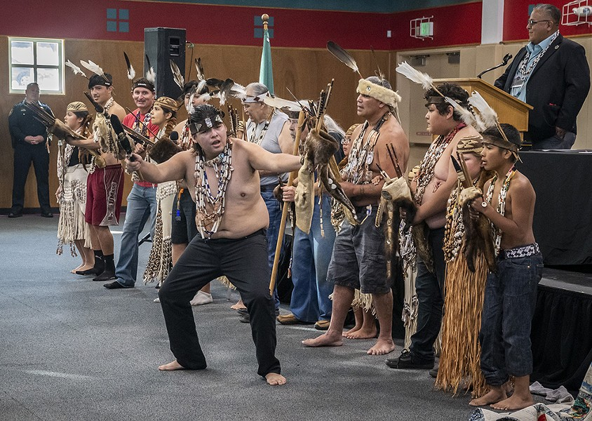 Wiyot tribal members perform the Brush Dance, a dance of healing, during the ceremony commemorating the repatriation of Duluwat Island to the tribe. - BY MARK LARSON