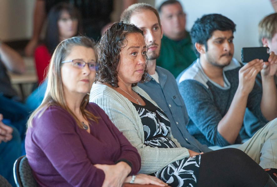 Concerned parents listen as Fortuna officials speak at a press conference. - MARK MCKENNA