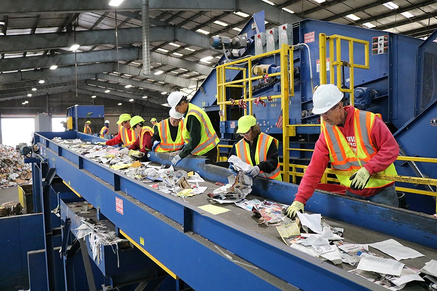 Community members and Eureka city officials working on the paper sorting line at Recology on Nov. 10.