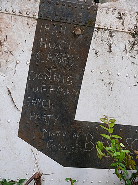 After finding the U.S. Coast Guard Helicopter that crashed during a rescue effort, killing all seven aboard, members of the search party signed a piece of the wreckage. - PHOTO COURTESY OF GREG RUMNEY