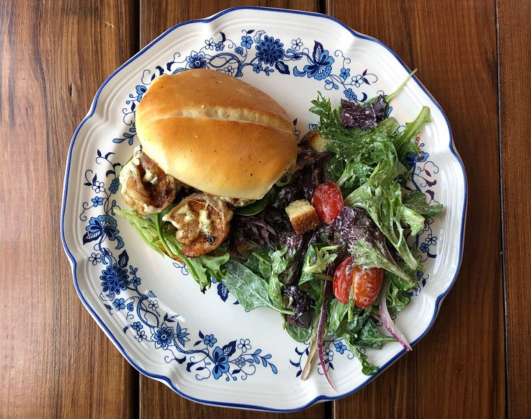 The shrimp po' boy with remoulade and salad. - PHOTO BY JENNIFER FUMIKO CAHILL