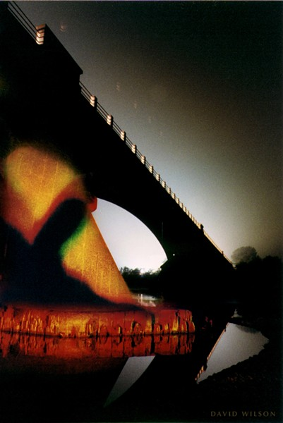 """Shadow of Himslef."" The eerie shadow of the creature spread across one of Fernbridge's giant supports. Fernbridge, Humboldt County, California. 1997. - PHOTO BY DAVID WILSON"