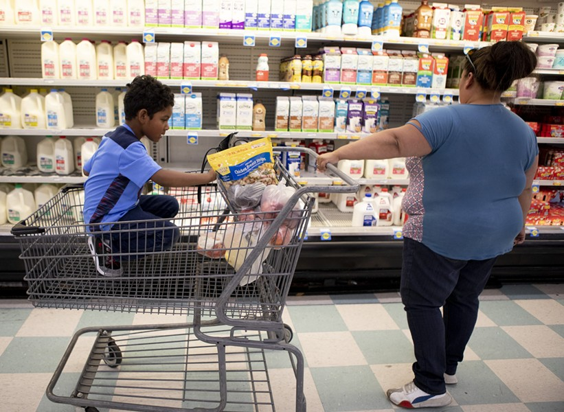 California is sending pandemic food cards to qualifying students. In this file photo, Antionette Martinez and her son Caden, 5, who receive CalFresh, do their weekly grocery shop at FoodMaxx on July 26, 2019. - ANNE WERNIKOFF FOR CALMATTERS