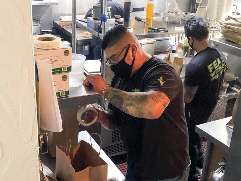 Edson Romero, 34, works as a server at Sage Bistro. His family's income is about 10 percent of what it was pre-pandemic. - NIGEL DUARA FOR CALMATTERS