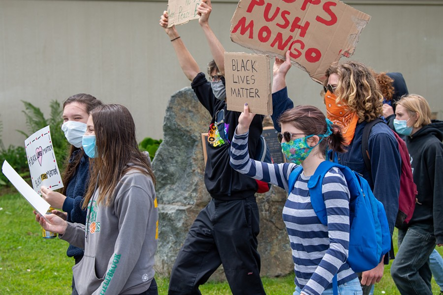 Protesters march through McKinleyville. - MARK MCKENNA