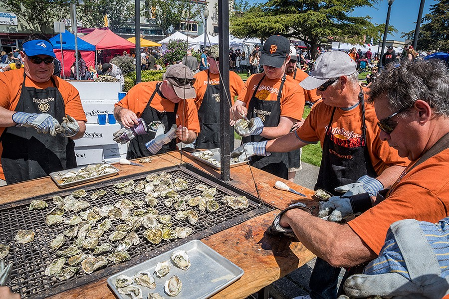 A Pacific Seafood oyster-shucking crew. - PHOTO BY MARK LARSON