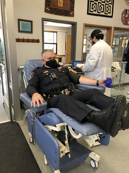 EPD Capt. Brian Stephens donates during the blood drive. - EPD