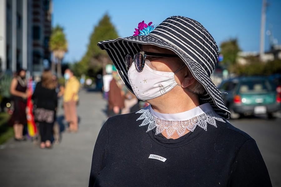 "Elizabeth Rose of Arcata wore an ""I Dissent"" sticker at the vigil for Ruth Bader Ginsburg. - MARK MCKENNA"