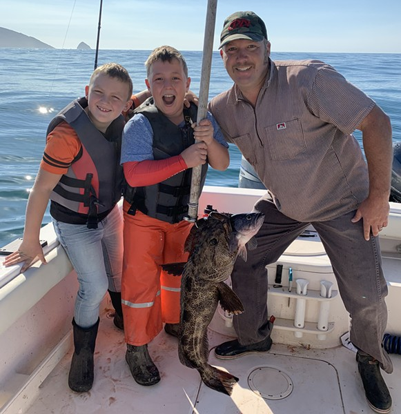 Riley Schneider, center, along with brother Parker and dad Travis, were all smiles after Riley landed his first-ever lingcod on his own while fishing near Cape Mendocino last Thursday. - PHOTO COURTESY OF TIM PETRUSHA