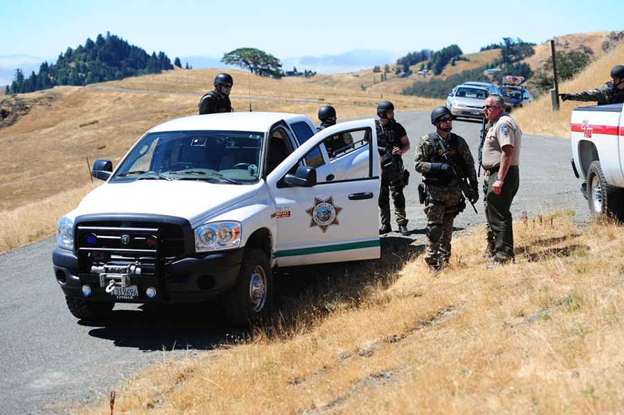 Humboldt County Sheriff's Office personnel stage about a mile away from Wilde's Ashfield Ranch property on Aug. 26, 2010. - FILE