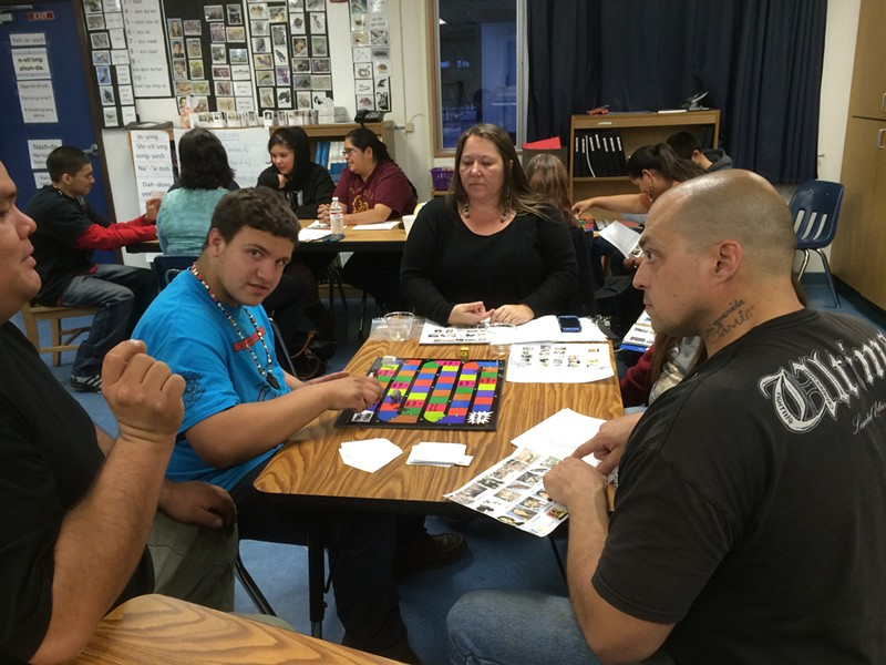 Robert Wilkins (in blue) leads a community class in Wailaki with fellow student Blaze Burrows (wearing black, at rear.) - LINDA STANSBERRY