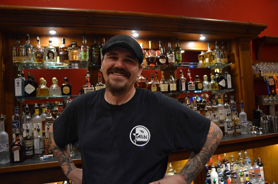 Bartender Stephen Shawles happily poured drinks from the new east-facing bar. - GRANT SCOTT-GOFORTH