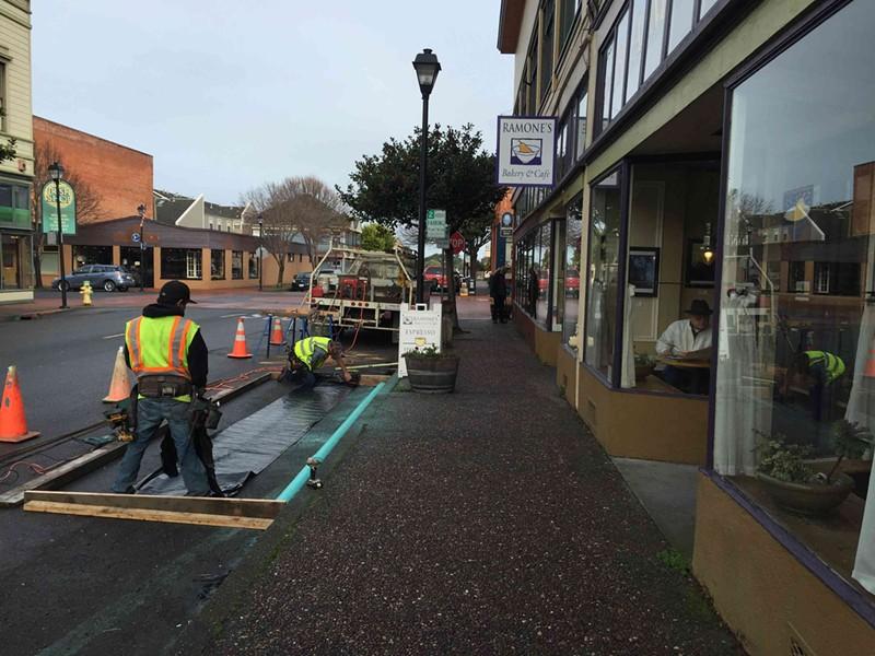 Construction crews measure out the parklet's dimensions. - GRANT SCOTT-GOFORTH