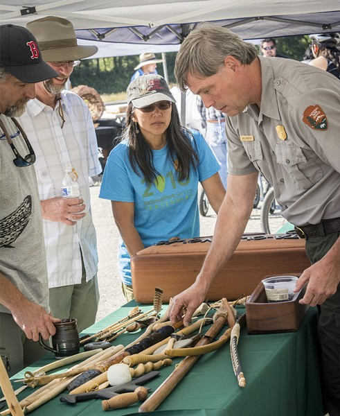 Dale Webster, a Redwood National Park employee and Yurok tribal member, displayed several of his handcrafted traditional items. - MARK LARSON
