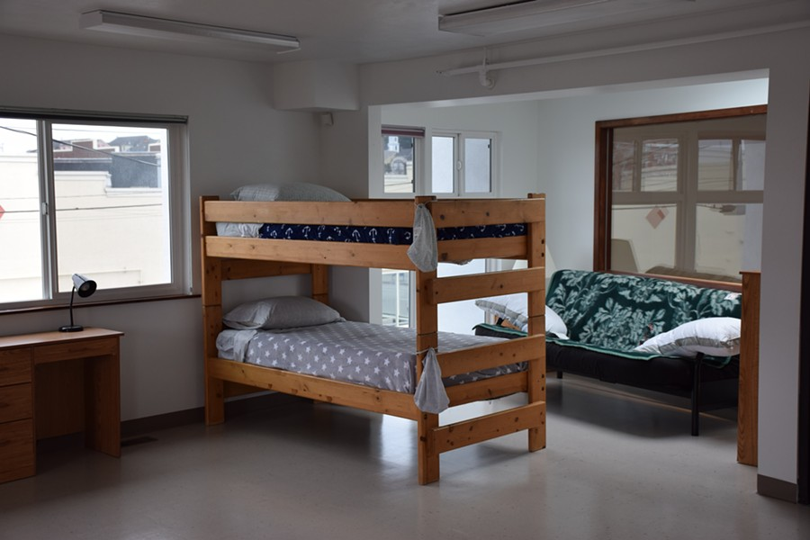 A bunk bed sits in the newly remodeled family shelter, which is decorated with donated art and furniture. - THADEUS GREENSON