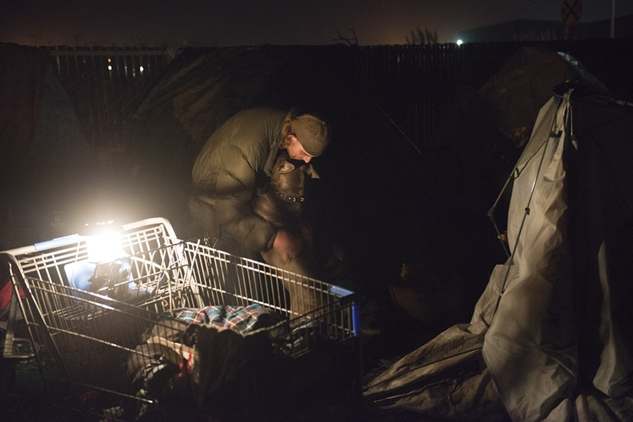 A man and his dog at the temporary free camping area near the Wharfinger Building on Wednesday night. - MARK MCKENNA