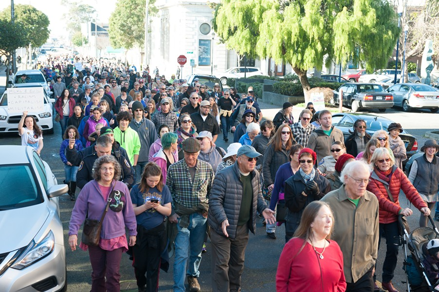 A crowd stretching several blocks marched through Eureka with the Eureka branch of the NAACP and the Eureka Police Department in honor of Martin Luther King Day. - MARK MCKENNA