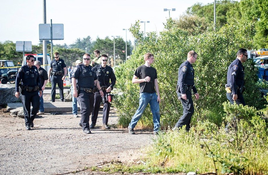 Officers prepare to enter the marsh on May 2, 2016. - FILE