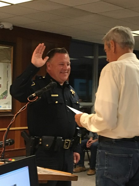 New chief Steve Watson beams as he takes the oath of office. - PAM POWELL