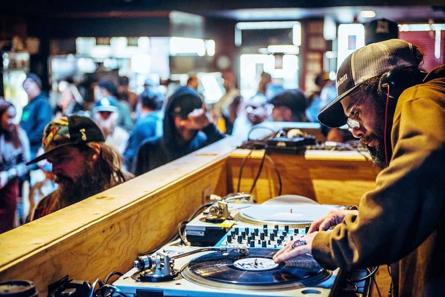 DJ Rickshaw spinning Lee's favorite tunes. - PHOTO BY ZEV SMITH-DANFORD