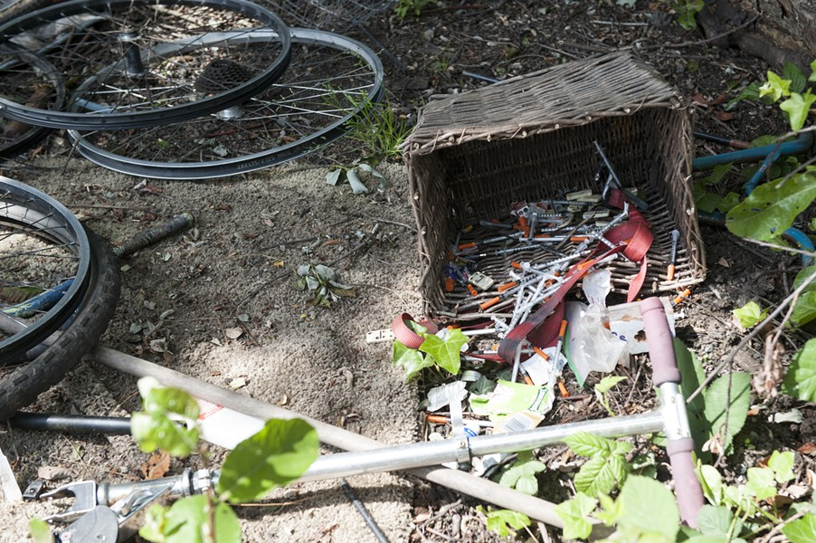 Needles discarded in a homeless camp. - MARK MCKENNA