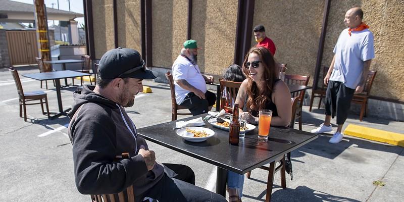 Head chef of Five Eleven Josh Wiley and his girlfriend Cheyanne Samson enjoyed empanadas int the ersatz parking lot cafe.