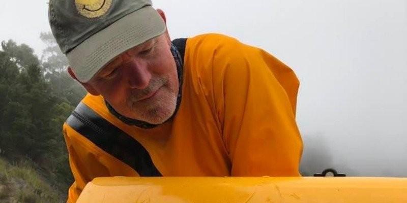 David Alexander and the shark's toothmarks in his kayak.  David Alexander