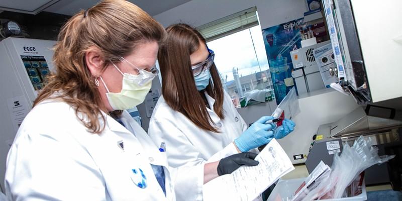 Humboldt County Public Health Laboratory staff Paula Moon (left) and Alyssa McCloud catalog incoming tests.
