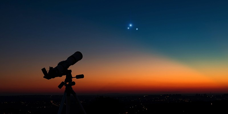 Photo illustration of the triple conjunction.