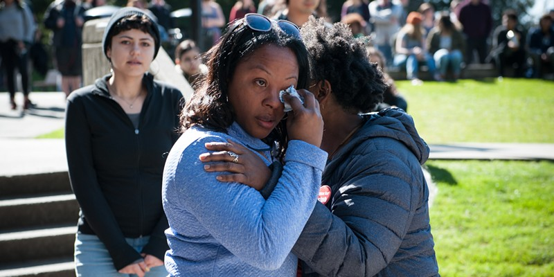 Charmaine Lawson dabs her eyes before addressing the crowd at a vigil held for her son at Humboldt State University in 2019.