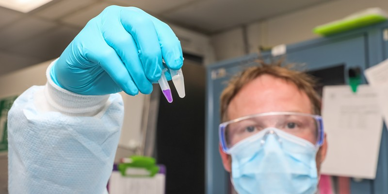 Humboldt County Lab Manager Jeremy Corrigan displays the reagents needed to amplify COVID-19 RNA in a test sample.